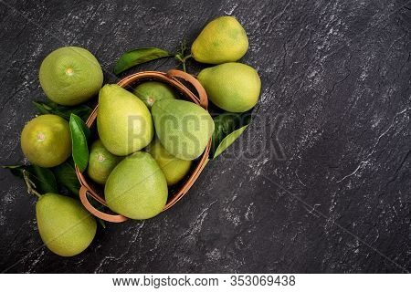 Fresh Peeled Pomelo, Pummelo, Grapefruit, Shaddock On Dark Background In Bamboo Basket. Autumn Seaso