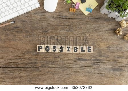 Possible, Wooden Cube With A Possible Message Placed On An Old Wooden Desktop, Top View.