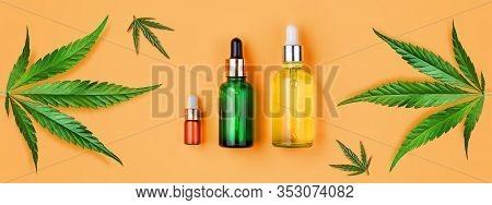 Glass Bottles Cbd Oil, Thc Tincture, Hemp Leaves On Yellow Background. Flat Lay Cosmetics Cbd Hemp O