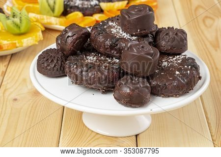 Tasty Treats, Sprinkled With Coconut, On A White Tray On Wooden Table. Delicious Chocolate Dietary C