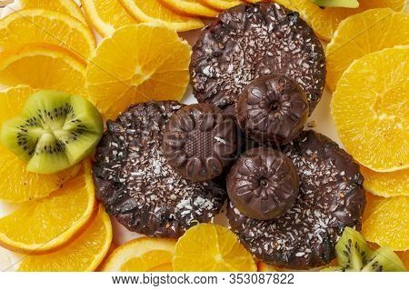 Delicious Vegan Snack. Top View Background. Chocolate Candies And Cookies Sprinkled With Coconut Fla