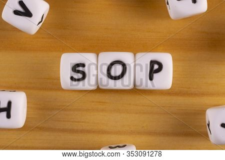 The Word Sop - Standard Operating Procedure Word Concept On White Plastic Cubes