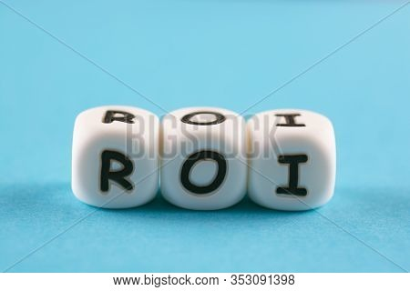 Return On Investment, Roi. Cube Plastic Block With Alphabet Building The Word Roi.