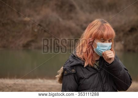 Girl With Medical Mask Coughing. Mask To Protect Her From Virus .woman With Mask For Coronavis. Peop
