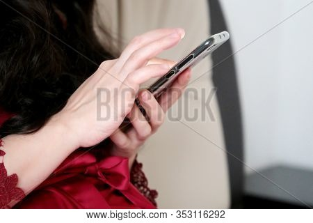 Woman Using Smartphone At Home In A Bed, Mobile Phone In Female Hands. Concept Of Online Addiction,