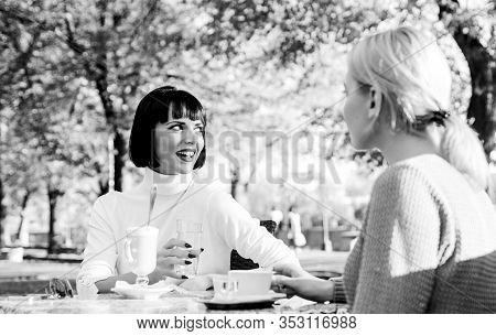 Girls Friends Drink Coffee And Enjoy Talk. True Friendship Friendly Close Relations. Conversation Of