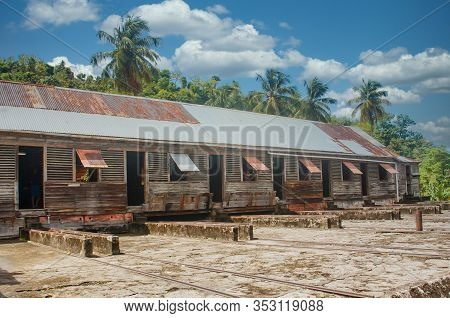 Old Warehouse Of Rough, Weathered Lumber With Corrugated Tin Roof