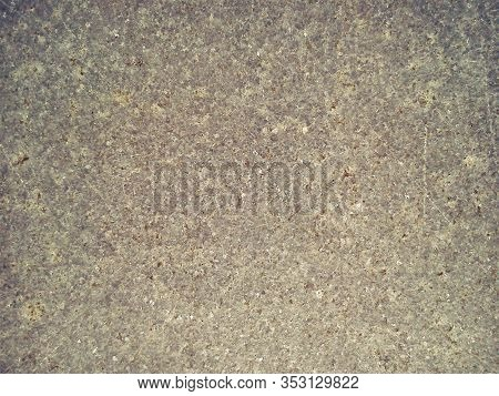 Granite Is Beige-brown In Color With Small Light And Dark Specks, Uneven Scratches. The Texture Of T