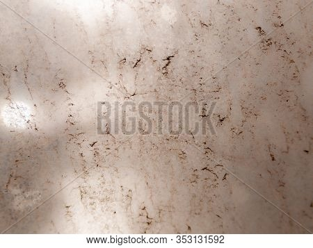 The Background Of A Very Dirty Glass Through Which The Sunlight Barely Breaks Through.