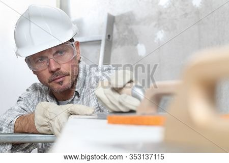 Man Work, Professional Construction Worker  With Plastering Tools On Scaffolding, Safety Hard Hat, G