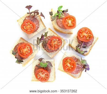 Small Sandwiches, Finger Food, With Sliced Salami, Tomatoes And Micro Greens Radish Isolated On Whit