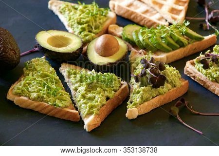 Breakfast  Sandwiches With Avocado. Toasts With Mashed Avocado And Micro Greens.