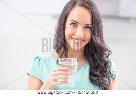 Young Woman Drinks Clean Water Adheres To Drinking Regime.