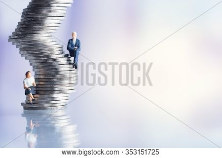 Miniature People: Elderly People Sitting On Coins Stack. Social Security Income And Pensions. Money