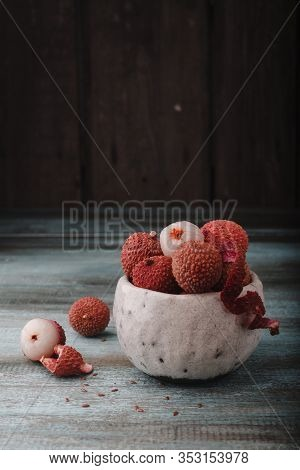 Litchi Chinensis With Copy Space. Fresh Litchi Fruits In A Bowl In Old Rustic Wooden Background. Raw
