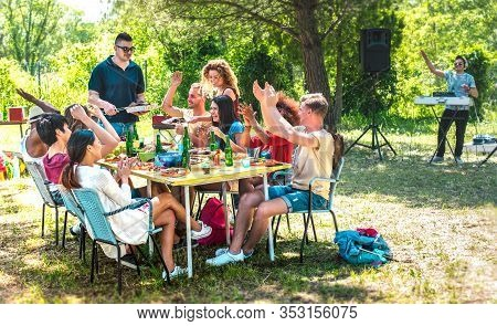 Happy Friends Having Fun Together At Barbeque Pic Nic Party - Multiracial Young People At Open Air F
