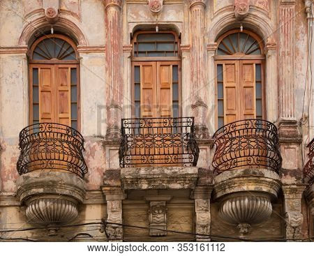Three beautiful wooden doors with wrought iron staircase colonial style in Havana in Cuba
