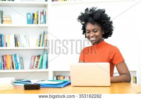 African American Young Adult Woman Shopping Online At Computer At Unibersity