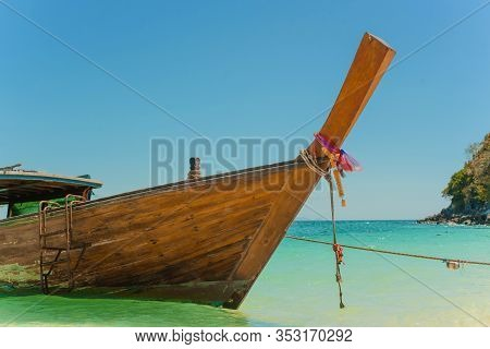 Traditional Thai Longtail Boat Moored On Exotic Beach.