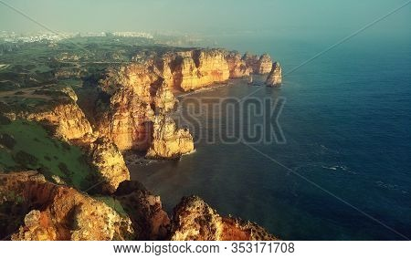 Aerial Panoramic Image Above View Of Ponta Da Piedade Headland With Group Of Rock Formations Yellow-