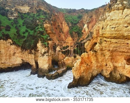 Aerial Photo Above View Of Ponta Da Piedade Headland With Group Of Rock Formations Yellow-golden Cli