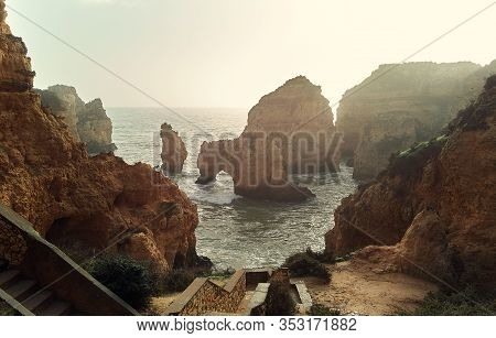 Above View Of Ponta Da Piedade Headland With Group Of Rock Formations Yellow-golden Cliffs Along Lim