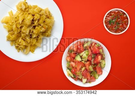 Stewed Cabbage In A White Plate On A Red Background. Stewed Cabbage Top View. Healthy Eating. Vegeta