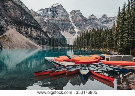 Canoes On A Jetty On The Beautiful Turquoise Waters Of Moraine Lake. Moraine Lake Is Located In Banf