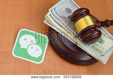 Wechat Paper Logo Lies With Judge Gavel And Hundred Dollar Bills. Entertainment Lawsuit Concept