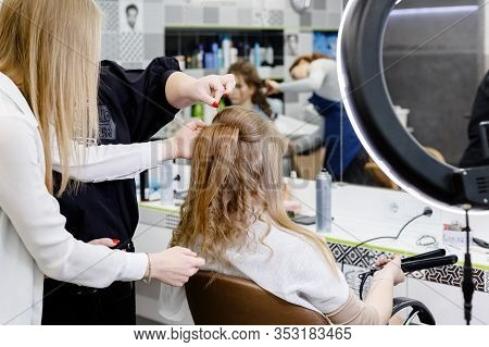 Hairstyle In Hair Training Center For Hairdresser Stylist. Hairdresser Making Hairstyle To Blonde Ha