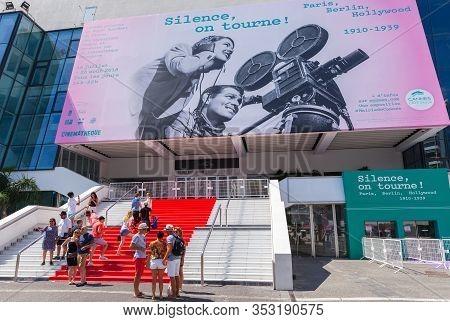 Cannes, France - August 14, 2018: Tourists Are Near The Palais Des Festivals Et Des Congres, It Is A