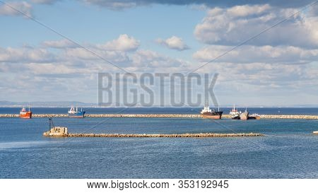 Famagusta Waterfront.  The View From The Famagusta Waterfront Across The Wave Breaker Towards The Me
