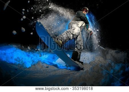 Male Freerider Doing Stunts On Blue Light Background