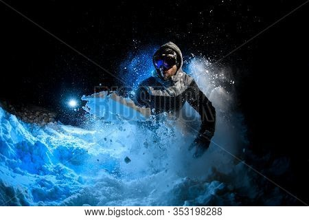 Man Freerider Doing Stunts On Blue Light Background