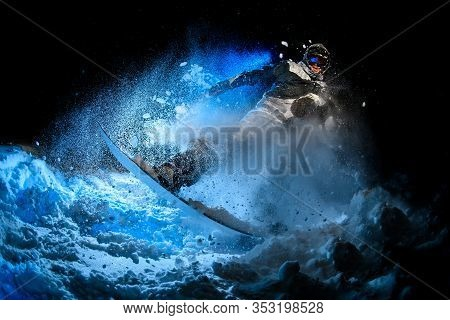 Male Freerider Doing Stunts In Night Time In Mountains