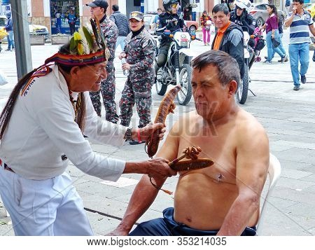 Cuenca, Ecuador - October 30, 2019: Unidentified Indigenous Healer (shaman) Performing Traditional F