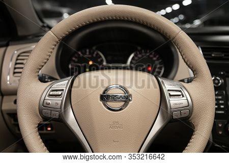 Novosibirsk, Russia - December 29, 2019:  Nissan Teana,  Black Luxury Car Interior - Dashboard, Play