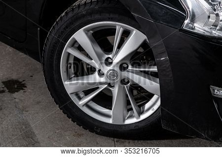Novosibirsk, Russia - December 29, 2019:  Nissan Teana, Car Wheel With Alloy Wheel And New Rubber On