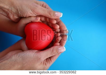 Close-up In Female Palms Childrens Hands And Heart. Timely Diagnosis Facilitates Treatment. Preventi