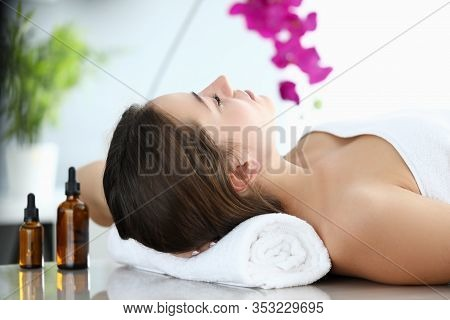 Girl Lies In Massage Parlor, Near Aromatic Oils. Way To Improve Your Health And Well-being. Effectiv