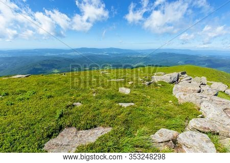 Rocks On The Alpine Meadow. Wonderful Summer Landscape Of Runa Mountain. Rural Valley In The Distanc