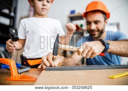 Happy Father And Son Working With Nails Stock Photo