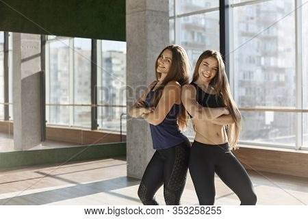 Cheerful, Coquettish Good-looking, Fit Athletic Women, Two Girls Invite Get Membership In Fitness Cl