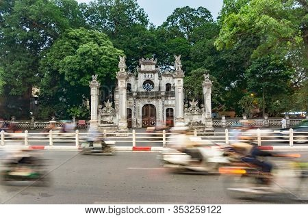 Hanoi, Vietnam Oct 16, 2019. Entrance Gate To The Quan Thanh Temple. View Through Traffic In The Ear