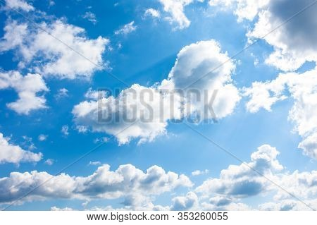 Gorgeous Cloudscape In Springtime. Weather Background With Dynamic Cloud Arrangement On A Blue Sky.