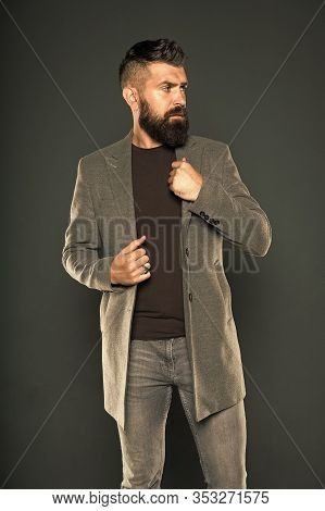 Beardy Hipster. Hipster On Grey Background. Bearded Hipster Wear Casual Jacket And Jeans. Brutal Man