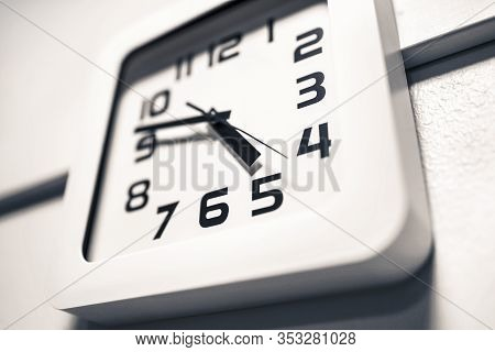 Modern Clock On A Wall. Almost 5 O'clock In The Afternoon Or Morning. Over Time At Work. Dramatic An