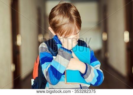 School Bullying Concept. Sad Little Boy At School. Offended Child. Primary School. Bullied School Bo