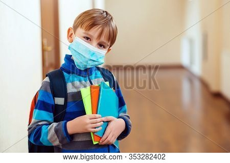 Schoolboy With Protect Mask On Face. Face Mask For Protection Coronavirus Outbreak. Medicine Healthc
