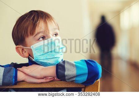 Schoolboy With Protect Mask On Face. Coronavirus Epidemic. A Child Wearing A Medicine Mask. Coronavi